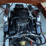 racing mercury 7.4 litre big block ChevyV8with a 400 hp racing cam, stainless steel risers and straight through pipes